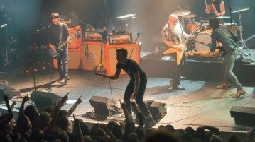 "American rock group Eagles of Death Metal perform on stage on November 13, 2015 at the Bataclan concert hall in Paris, few moments before four men armed with assault rifles and shouting ""Allahu akbar"" (""God is great!"") stormed into the venue. Islamic State jihadists on November 14, 2015 claimed a series of coordinated attacks by gunmen and suicide bombers in Paris that killed at least 128 people in scenes of carnage at the Bataclan, restaurants and the national stadium.   AFP PHOTO / ROCK&FOLK / MARION RUSZNIEWSKI"