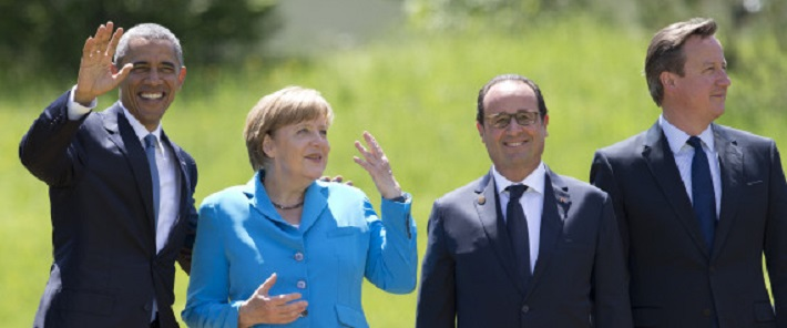 From left, US President Barack Obama, German Chancellor Angela Merkel, French President Francois Hollande and British Prime Minister David Cameron, gather to pose for a group photo during the G-7 summit in Schloss Elmau hotel near Garmisch-Partenkirchen, southern Germany, Sunday, June 7, 2015. (AP Photo/Carolyn Kaster)