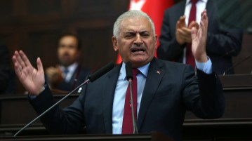 epa05431810 Turkish Prime Minister Binali Yildrim speaks during a meeting at the Turkish parliament in Ankara, Turkey, 19 July 2016. Turkish Prime Minister Yildirim reportedly said that the Turkish military was involved in an attempted coup d'etat. Turkish President Recep Tayyip Erdogan has denounced the coup attempt as an 'act of treason' and insisted his government remains in charge. Some 104 coup plotters were killed, 90 people - 41 of them police and 47 are civilians - 'fell martrys', after an attempt to bring down the Turkish government, the acting army chief General Umit Dundar said in a televised appearance.who were killed in a coup attempt on 16 July, during the funeral, in Istanbul, Turkey, 17 July 2016. Turkish Prime Minister Yildirim reportedly said that the Turkish military was involved in an attempted coup d'etat. Turkish President Recep Tayyip Erdogan has denounced the coup attempt as an 'act of treason' and insisted his government remains in charge. Some 104 coup plotters were killed, 90 people - 41 of them police and 47 are civilians - 'fell martrys', after an attempt to bring down the Turkish government, the acting army chief General Umit Dundar said in a televised appearance.  EPA/STR